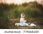 smiling baby girl sdending time ... | Shutterstock . vector #774068185
