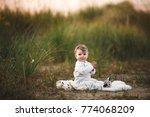 smiling baby girl sdending time ... | Shutterstock . vector #774068209