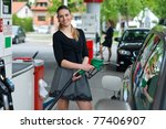 Woman Holding Green Nozzle At...