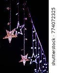 christmas stars wire light... | Shutterstock . vector #774072325