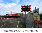 train passing red lights at an... | Shutterstock . vector #774078325