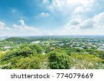 residential buildings and green ... | Shutterstock . vector #774079669