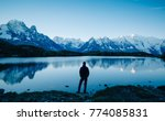 man looking over a lake at the... | Shutterstock . vector #774085831