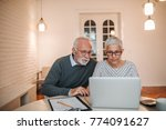 senior couple browsing the... | Shutterstock . vector #774091627