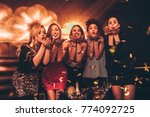 group of young women blowing... | Shutterstock . vector #774092725