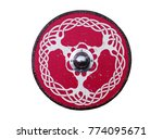 Stock photo a round wooden shield decorated with a knotwork tree design 774095671