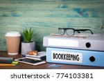 bookkeeping concept. binders on ... | Shutterstock . vector #774103381