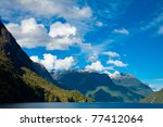 Clouds over the Lake Manapouri in the South Island of New Zealand - stock photo