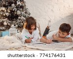 two little children draw... | Shutterstock . vector #774176431