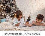 two little children draw... | Shutterstock . vector #774176431