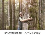 smiling woman hugging a tree in ...   Shutterstock . vector #774241489