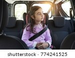 cute girl sitting in a car and... | Shutterstock . vector #774241525
