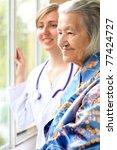 doctor and her patient | Shutterstock . vector #77424727