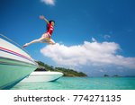 asian lady jump and fly to sky... | Shutterstock . vector #774271135