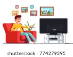 man wearing glasses sitting on... | Shutterstock .eps vector #774279295