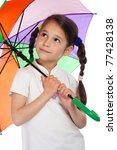 Little girl holding colored umbrella and looking to sky - stock photo