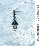 wrought iron lantern hanging on ... | Shutterstock . vector #774301495