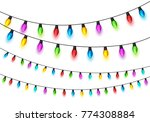 christmas glowing lights on... | Shutterstock .eps vector #774308884