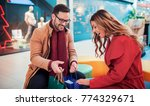 beautiful young couple enjoying ...   Shutterstock . vector #774329671