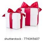 Two White Gift Boxes Tied...