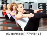group of young women in the gym ... | Shutterstock . vector #77445415