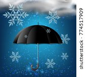 black umbrella and snow in the... | Shutterstock .eps vector #774517909