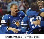 BRATISLAVA, SLOVAKIA - MAY 15: Finnish ice hockey players celebrate the victory in the gold medal game of World Cup. They beat the Swedish team 6-1 on May 15, 2011 in Bratislava, Slovakia. - stock photo
