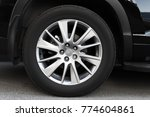modern automotive wheel on... | Shutterstock . vector #774604861