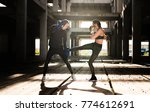 young athlete couple doing kick ... | Shutterstock . vector #774612691
