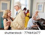 group of seniors enjoying... | Shutterstock . vector #774641677