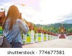 female tourist taking picture...   Shutterstock . vector #774677581
