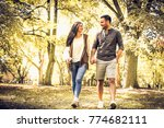 young couple walking and... | Shutterstock . vector #774682111