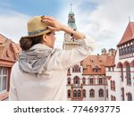 Stock photo woman traveler in hat enjoying hannover city view 774693775