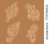 henna tattoo flower template in ... | Shutterstock .eps vector #774703411