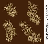 henna tattoo flower template in ... | Shutterstock .eps vector #774703975