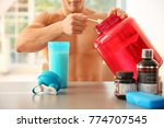 young sporty man preparing... | Shutterstock . vector #774707545