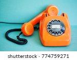 busy retro phone orange color ...   Shutterstock . vector #774759271