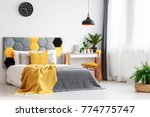 black lamp above bed with... | Shutterstock . vector #774775747