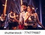 couples dancing in the nightclub | Shutterstock . vector #774779887