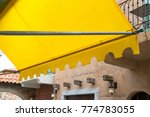 yellow awning of shop in... | Shutterstock . vector #774783055