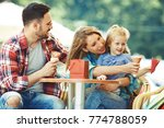 happy family enjoying ice cream ... | Shutterstock . vector #774788059