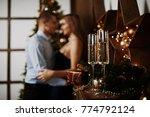 couple is celebrating christmas ... | Shutterstock . vector #774792124