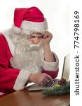 Small photo of Pensive Santa learning Computer science