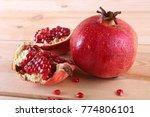 pomegranate on table | Shutterstock . vector #774806101