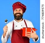 man with beard holds...   Shutterstock . vector #774809575