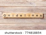 Small photo of Guidelines word written on wood block. Guidelines text on table, concept.