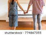 men and women stand hand in... | Shutterstock . vector #774867355