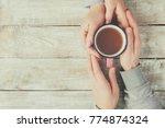cups of tea in the hands of men ... | Shutterstock . vector #774874324