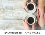 cups with a coffee in the hands ... | Shutterstock . vector #774879151
