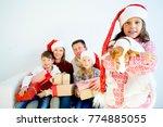 family celebrating christmas | Shutterstock . vector #774885055